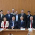 В Семее депутаты задержали дыхание, чтобы сделать фото без масок. Их оштрафовали