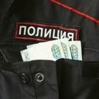 В Алматы осудили полицейского за взятничество и мошенничество